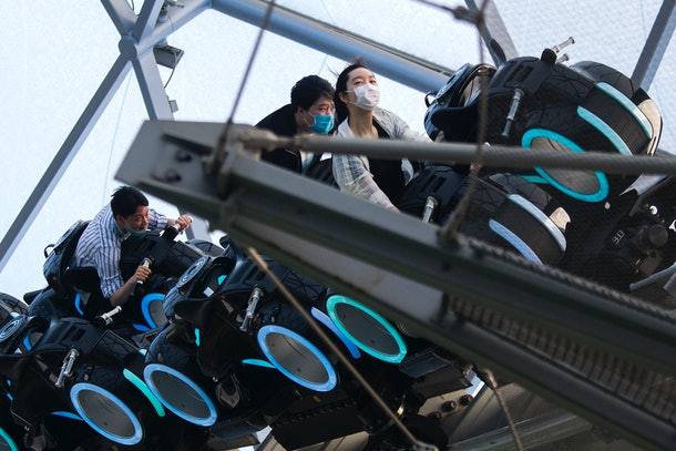 Guests wear mask as they ride rides