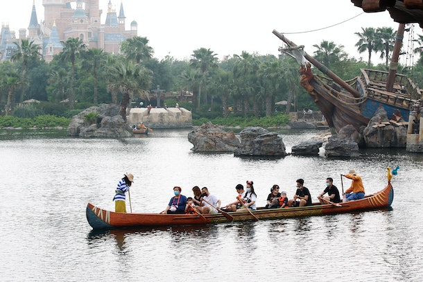 Guests enjoy a gondola ride through the park's waters