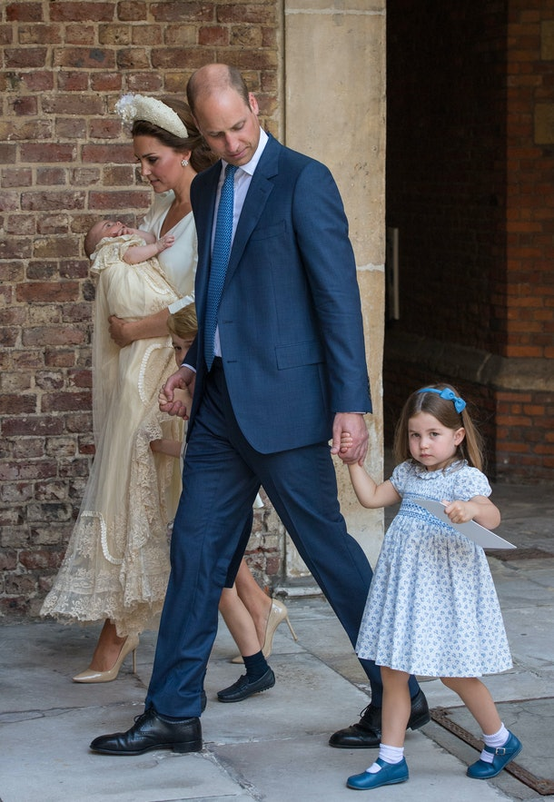 Princess Charlotte stares down the media as her dad hides a smirk.