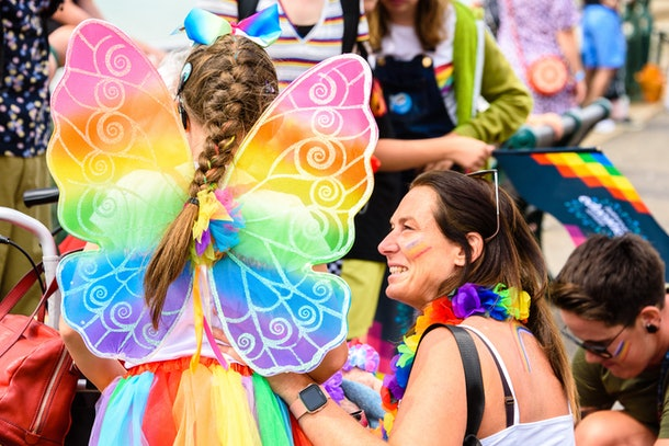 A girl in a butterfly costume celebrates Pride