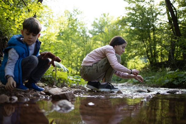 Experts say creeks warmed by the sun all day are not always great places for kids to play.