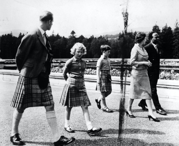 Prince Philip matching kilts with daughter Princess Anne and Prince Charles.