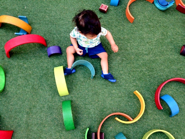 toddler playing with montessori toys