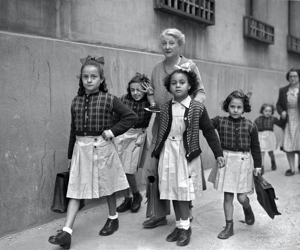 This vintage back to school photo shows a group of girls walking to school.