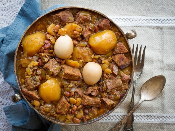 aerial view of bowl full of cooke potatoes beef and beans in a stew