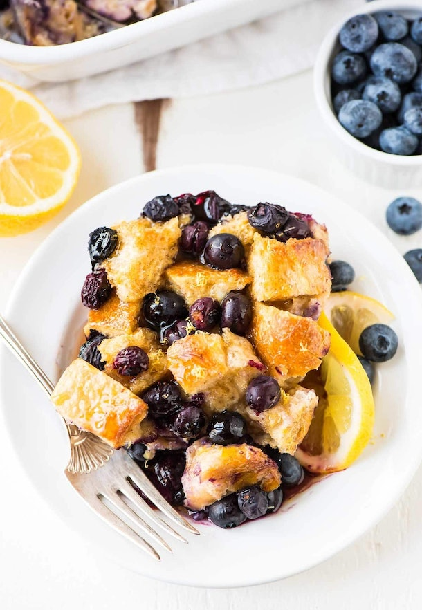 plate full of french toast covered in blueberries
