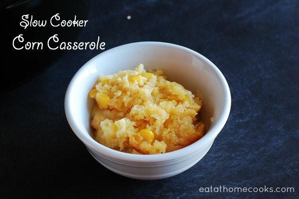 bowl of corn casserole on dark grey countertop