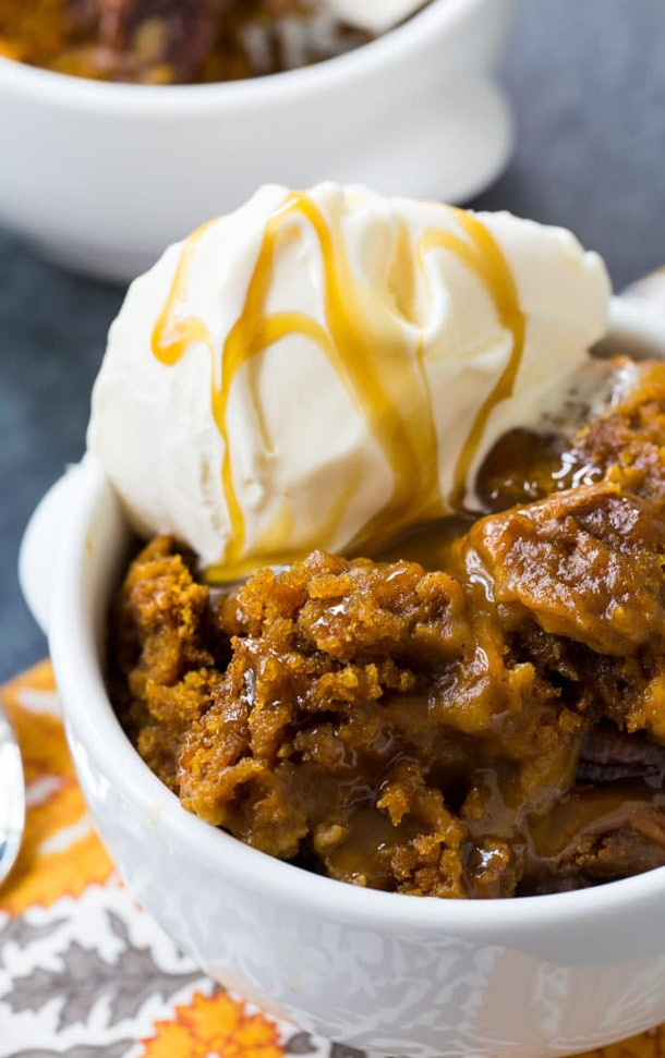 caramel covered deconstructed pumpkin cake with ice cream on top in a bowl with caramel drizzled over