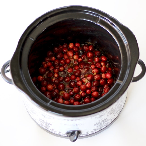 crock pot full of vibrant red cranberries