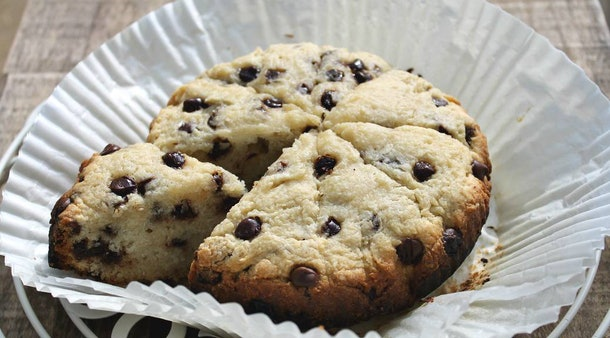 round cake-looking chocolate chip scone cut into triangles