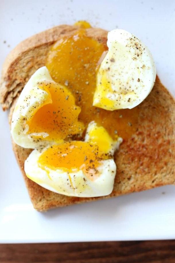 broken soft boiled egg on toast