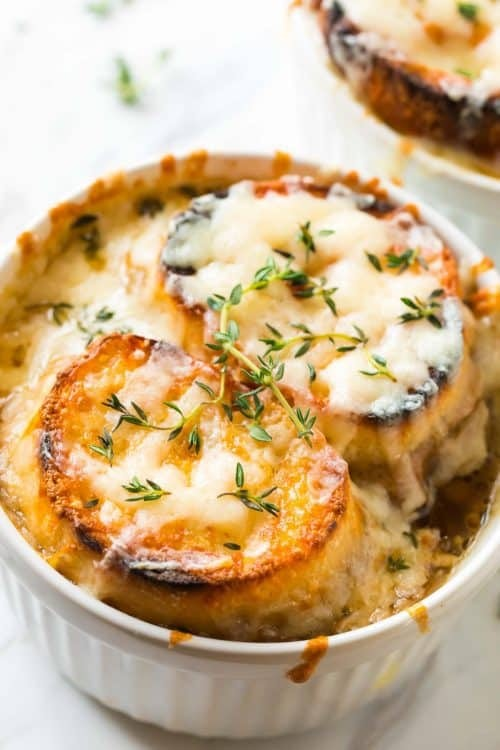 bowl of french onion soup with two slices of bread covered in cheese on top