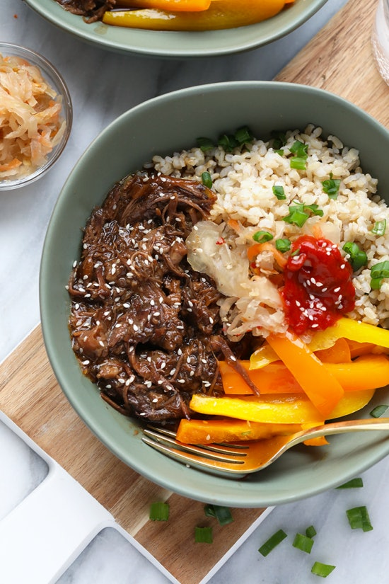 bowl with shredded beef, carrots onions and rice