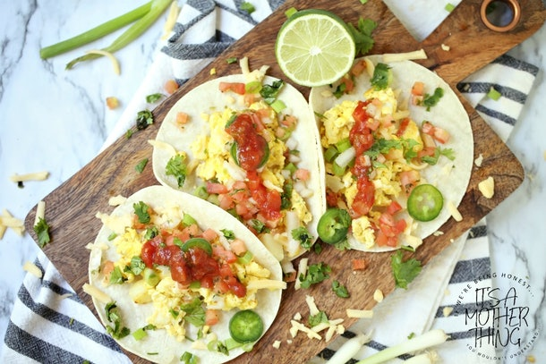 cutting board with 3 open faced breakfast tacos