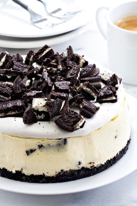 oreo cheesecake with an oreo crust and crushed oreos on top