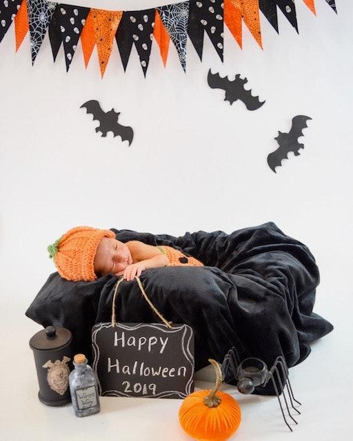 pics of babies dressed as pumpkins, newborn baby dressed as pumpkin, newborn photo shoot