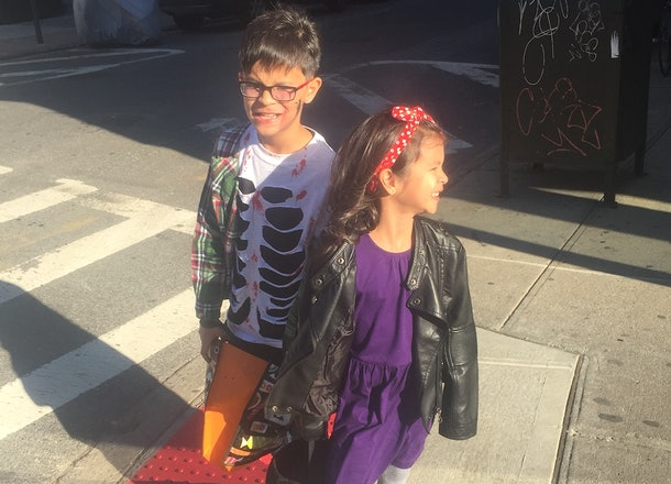 Child dressed in Kiki's Delivery Service Halloween Costume