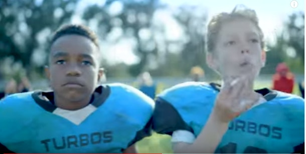 Young football players symbolically smoking to show the effect of concussion