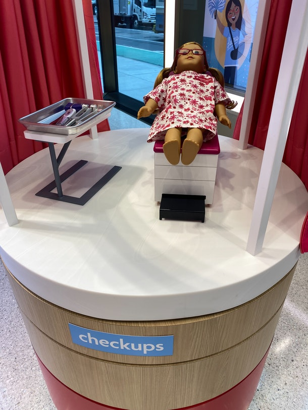 American Girl doll receiving health and wellness checkup at the hospital in NYC