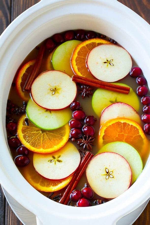 slow cooker apple cider in crock pot with cinnamon and cranberries