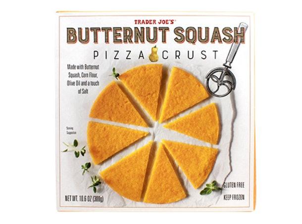 A picture of bright orange butternut squash pizza crust.