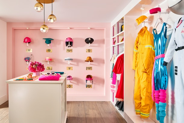 Walk in closet at barbie malibu dream house complete with Barbie outfits