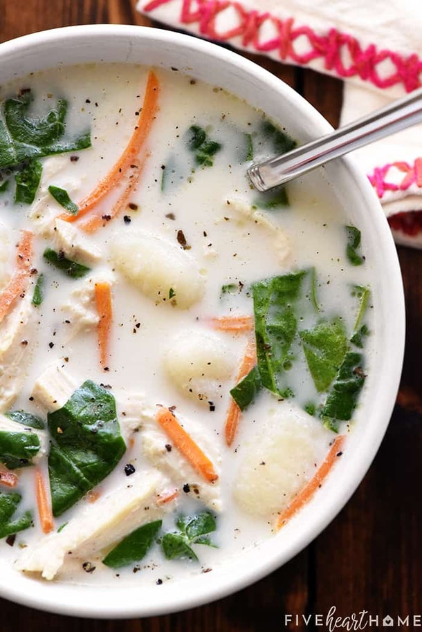 close up of slow cooker chicken gnocchi soup in white bowl