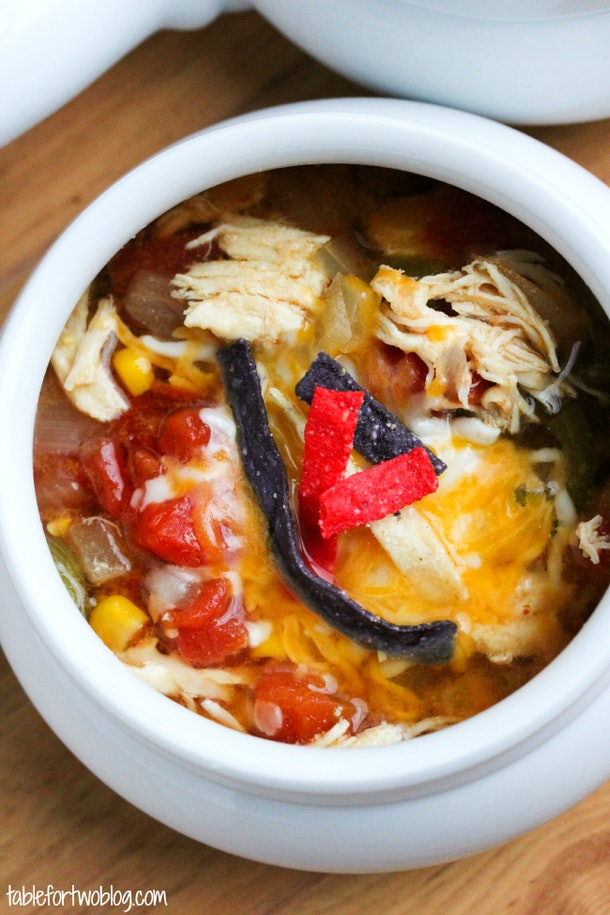 close up of slow cooker chicken tortilla soup in white bowl