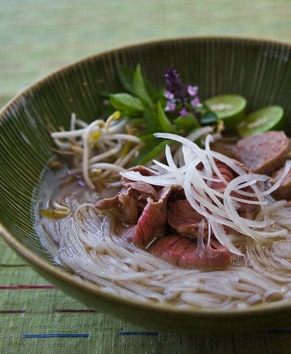close up sideview of a bowl of slow cooker pho in a bowl