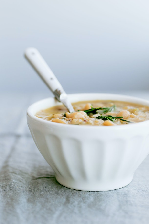 slow cooker cannellini bean soup in white bowl