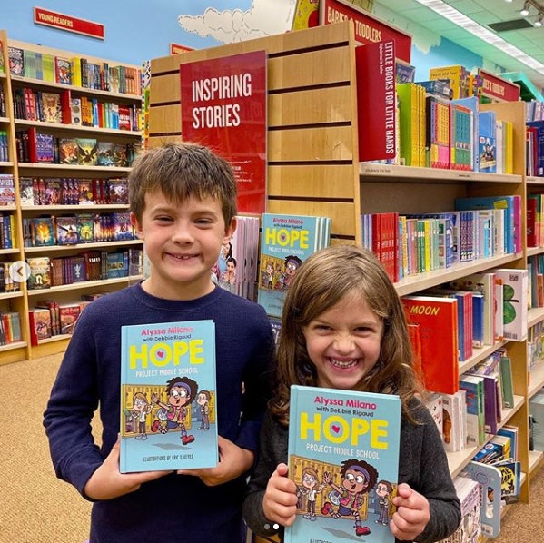 Milano's two children Milo and Elizabella buying copies of their mother's book in NYC