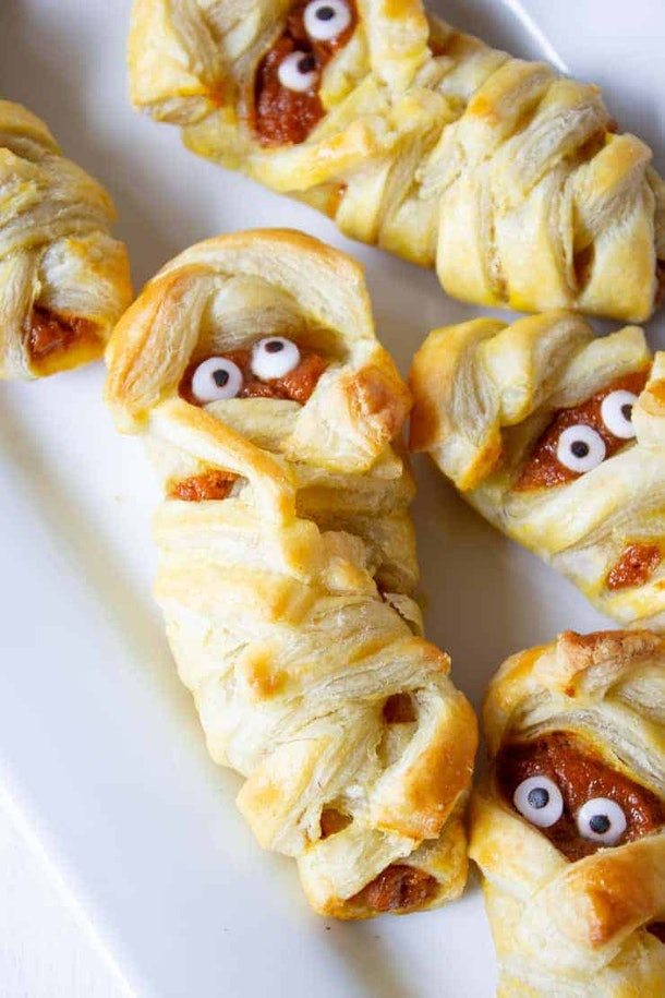 These Halloween mummy-shaped hand pies are fun and easy to make.