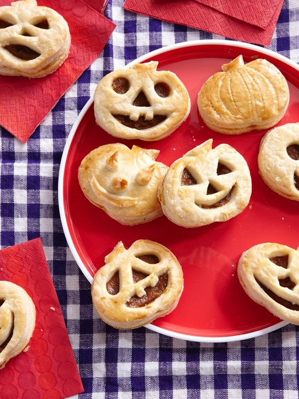 Use store-bought pumpkin pie filling to make these Halloween pumpkin tarts.