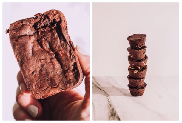 A chocolate brownie and a stack of chocolate cups