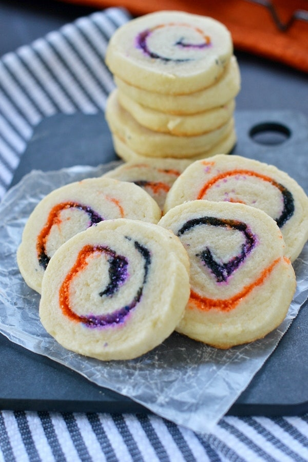 Halloween spiral slice and bake cookies feature purple and orange sprinkles inside, perfect for a Halloween snack for the classroom.