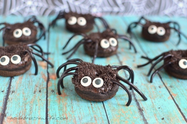 Chocolate pumpkin spider donuts are a delicious Halloween snack for the classroom.