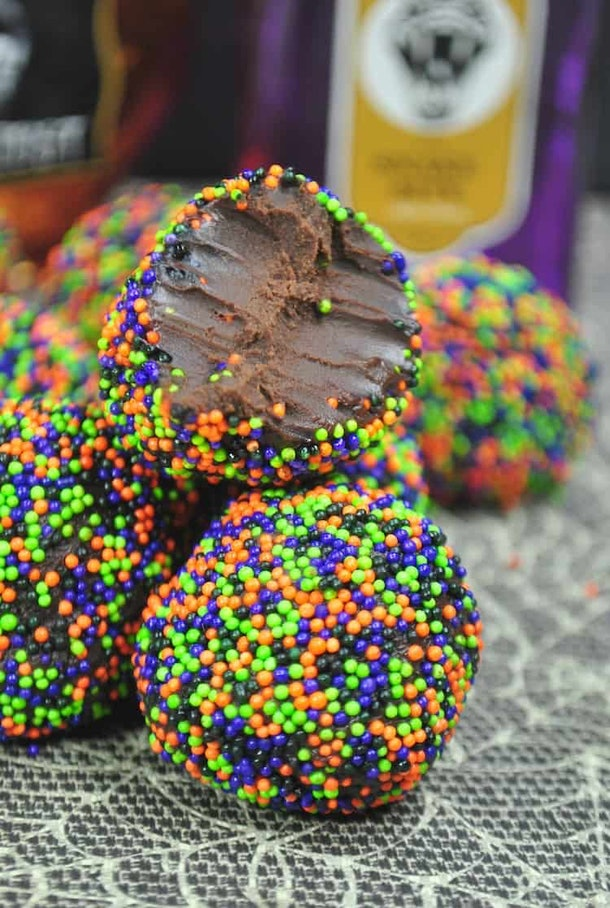 Halloween chocolate truffles are a sweet treat that can be a Halloween snack for the classroom.