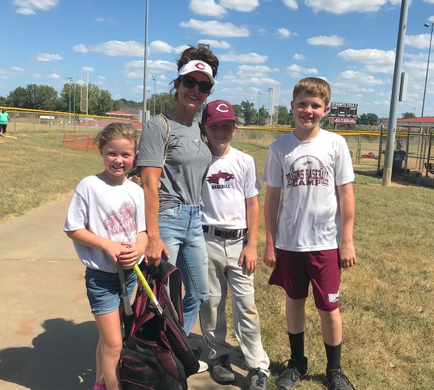 Bridgett Spillers and her kids on a baseball field.