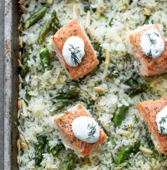 Sheet Pan Salmon and Rice with Lemon Dill Sauce recipe from Cooking for keeps is a meal with plenty of protein and veggies
