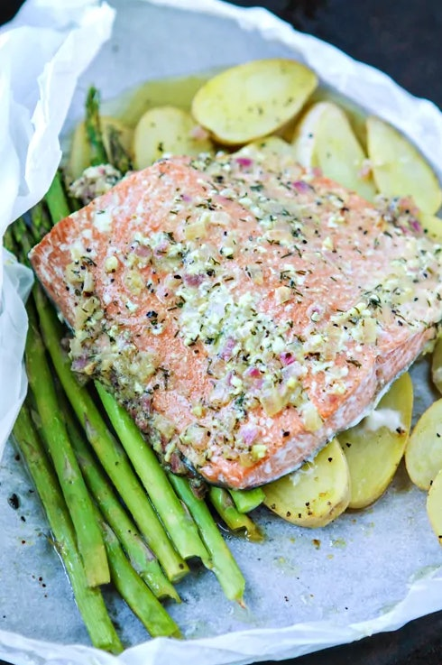 Salmon en papillote with asparagus recipe from Good Life Eats is a classic and simple meal