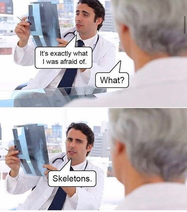 A doctor with a fear of skeletons looking at an X ray.