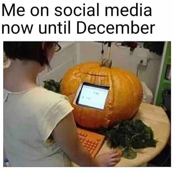 woman with a computer fashioned into a pumpkin