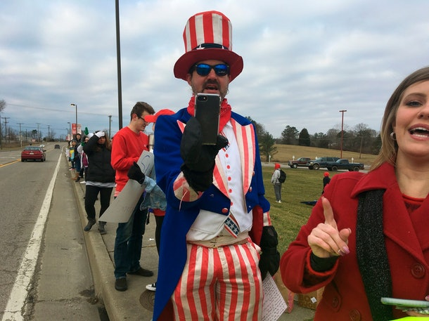 Cabell County teacher Parry Casto joins Putnam County teachers on the picket line at Hurricane High School, in Hurricane, W.Va.