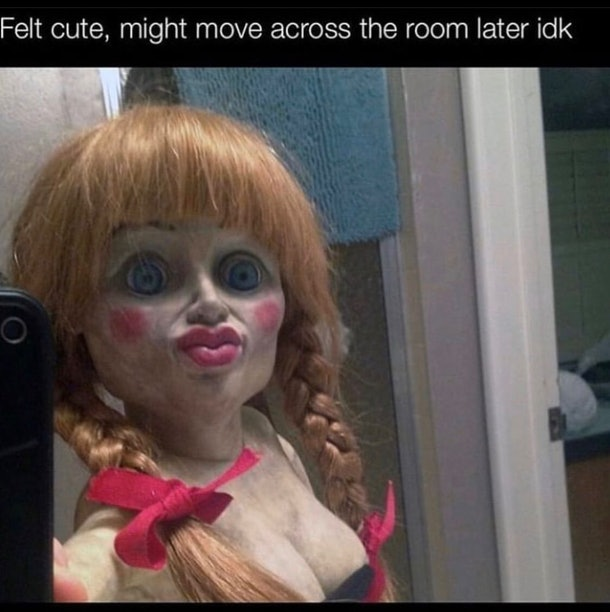 horrific porcelain doll staring at middle distance, ostensibly taking selfie