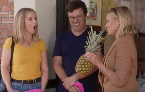 Kristen Bell gives a pineapple to a woman because they apparently are good for vagina health.