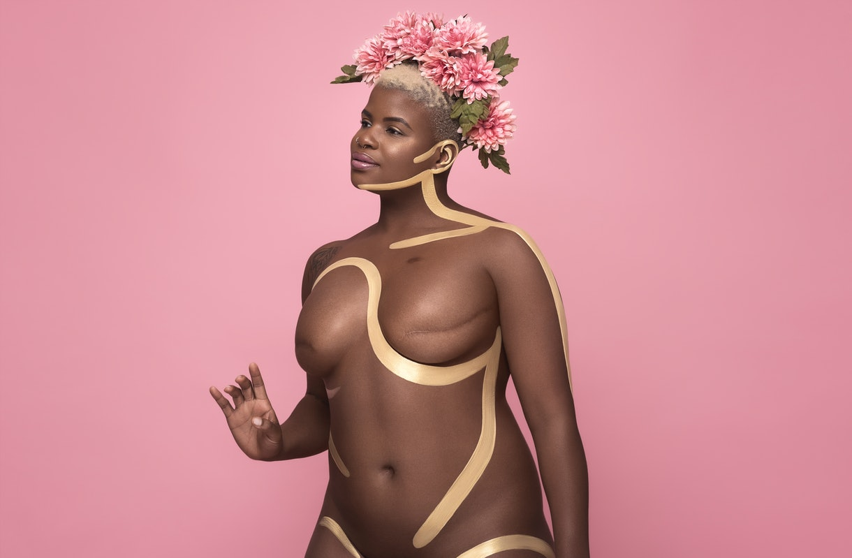 breast cancer awareness month confident african american woman double mastectomy scars body art paint