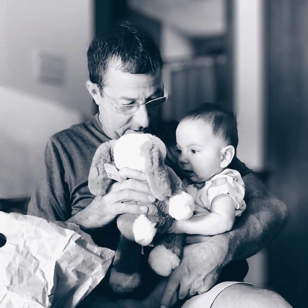 Emma's son, 6 months, gets his special comfort animal from his granddad