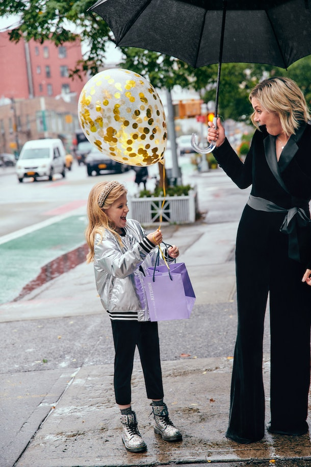 Mother and daughter in coordinate DVF X Rockets Of Awesome outfits on city street
