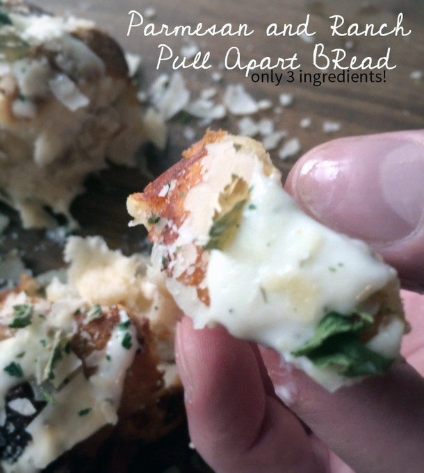 Easy Thanksgiving Dishes; Hand holding a piece of three-ingredient Parmesan ranch pull apart bread