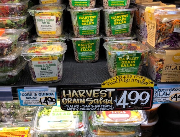 A picture of a container of harvest grain salad.